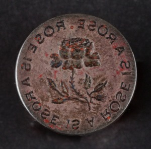 "Wax seal for embossing envelopes reading: ""Rose is a rose is a rose is a rose"" in a circle around a central rose graphic, Leuchars & Son Geffroy Suode Paris via Gertrude Stein and Alice B. Toklas Papers  Yale Collection of American Literature"