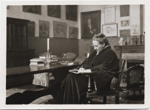 Photograph of Gertrude Stein in her salon, writing, c. 1920, Creator: Man Ray, from Gertrude Stein and Alice B. Toklas Papers, Yale Collection of American Literature in Beinecke Rare Book and Manuscript Collection.