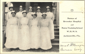 Figure 3. Nurses from the George A. Brewster Nurse Training School pose for a group portrait, Jacksonville, FL, 1908. Via U.S. National Library of Medicine.